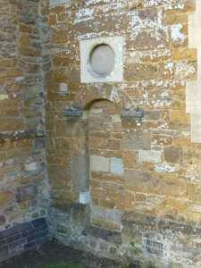 Blocked doorway to former school in Husbands Bosworth church