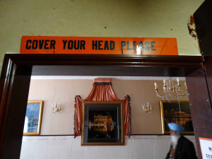 Figure 1: A sign at the Guru Nanak Gurdwara reminding visitors to cover their heads when in the gurdwara. © Clare Canning 2015